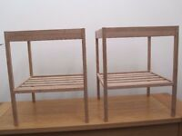 Pair of light wood bedside tables with glass tops