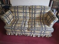 Two, 3 seater settes one yellow one yellow and blue checks, 2 yellow arm chairs and a stool