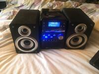 Mini stereo system, with CD player and FM radio.