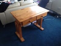 Solid pine desk (artist/drawing/dressing table). Very solid, good condition. Adjustable height.