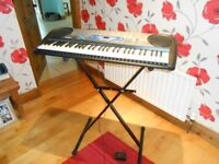 Casio LK-40 Electric keyboard with stand- Teaching system built in.