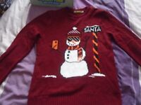2 christmas jumpers age 13-14 yrs