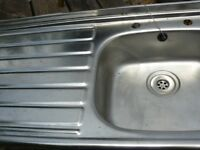 Stainless steel kitchen sink. Left hand drainer. Roll front edge. c/w waste fitting & plug.