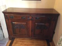 Side board with carved drawers and doors.
