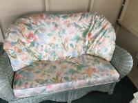 Pale green conservatory sofa and table