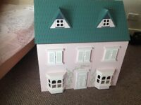 Beautiful dolls house in pink + greenIn great condition, comes with some furniture