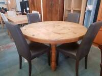 Large pine round table and 4 brown leather chairs