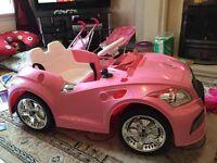 Girls sit on electric car.