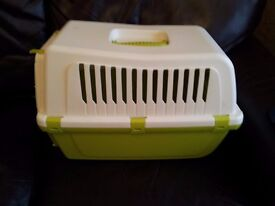 Pet carrier and litter tray.