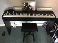 Keyboard piano with frame, pedal, stool and headphones £80