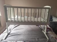 Mamas and papas swinging crib