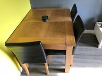 Extending dining table and 4 chairs (wax polish included)