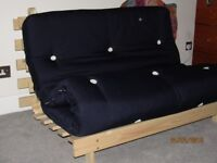 Futon (navy) - nearly new, been used twice - from pet and smoke free home.