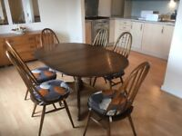 Ercol extendable pedestal dining table and 6 chairs