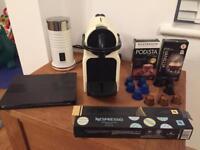 Nespresso coffee machine, milk warmer and pods