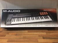 As new M-Audio Oxygen 49 USB Midi Keyboard Controller