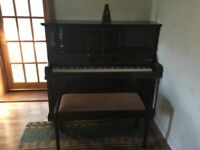 Upright piano seeking good home - OFFERS