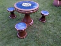 beautiful ornate oriental glazed garden or patio terracotta table and three stool set can deliver