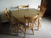 Round dropleaf kitchen table and 4 chairs with cushions.