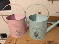 7 watering can centrepieces