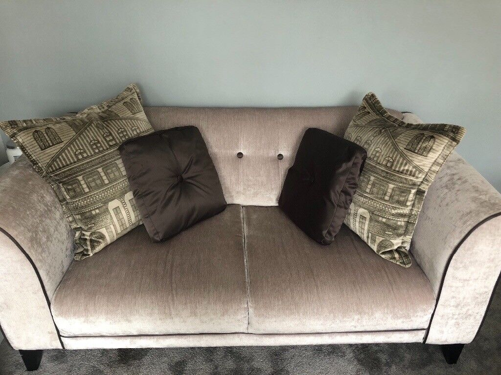 Four, and two seater sofas with footstool and cuddler