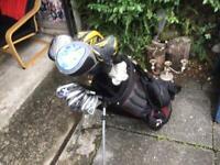 Bundle of 19 golf clubs and bag