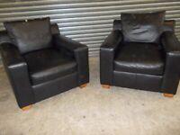 Two Designer Black Leather Armchairs (Sofa/Suite)