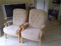 Arm chairs. Two matching white wood frame chairs for lounge or conservatory