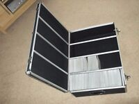 dvd/cd storage suit case made from aluminium and black rubber holds upto 900