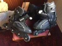 Men's Roller Blades, Size 10 with knee, elbow and hand protectors.