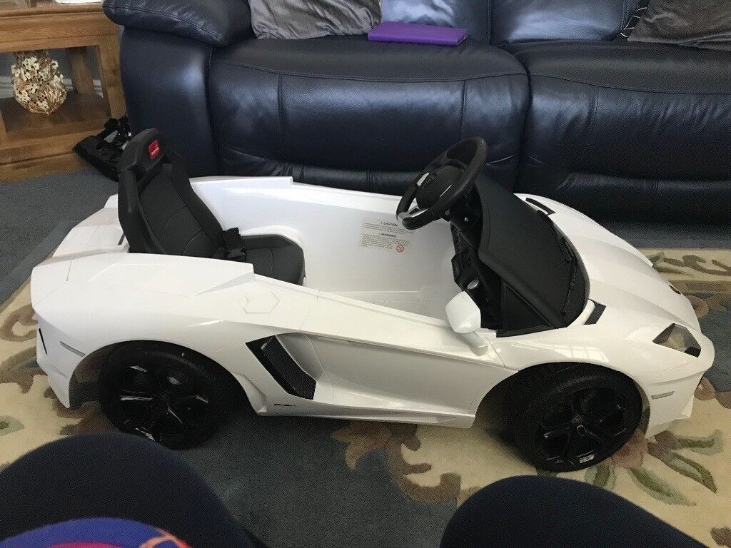 white lambergini toy sit in car exellent condition needs a new