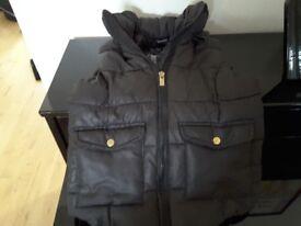2 Girls Zara coats in black.