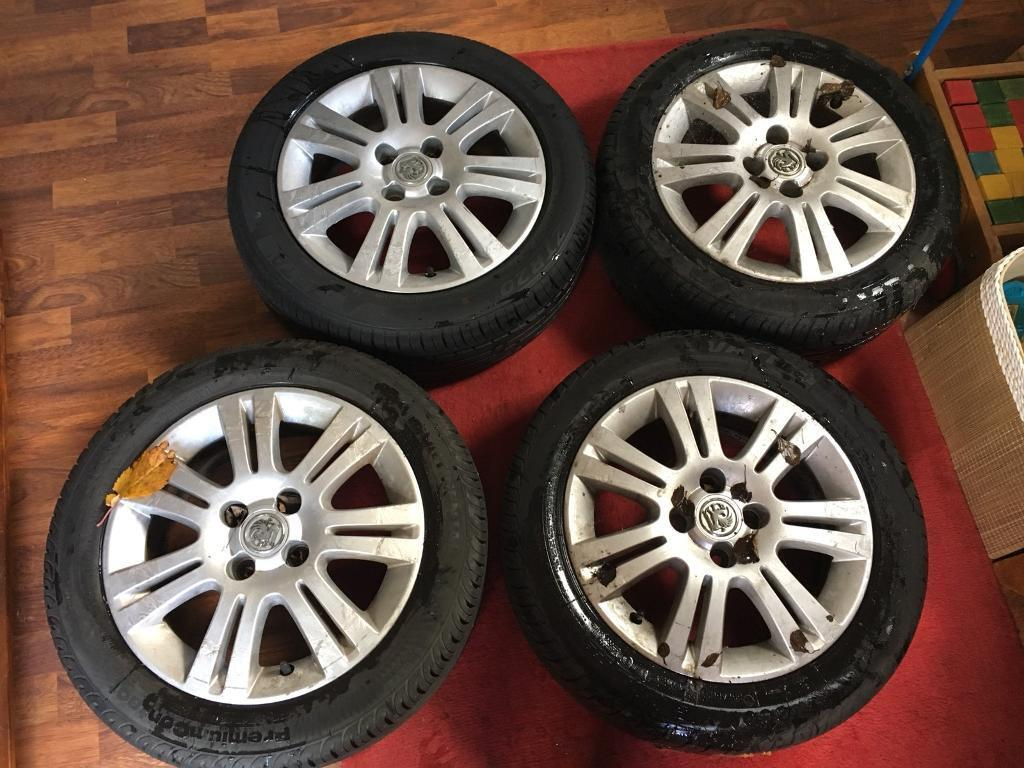 SET OF 4 VAUXHALL CORSA ALLOY WHEELS AND TYRES - 185 / 55 R15