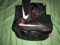 Size 10.5 Nike pink and black football boots