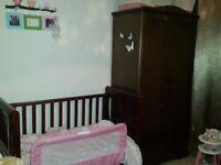 Nursery furniture set in dark wood