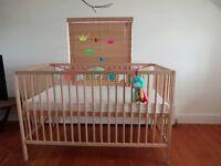 Wooden cot including mattress