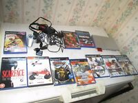 silver slimline ps2 bundle 10x games,controller