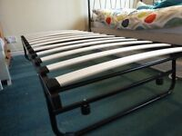 Folding bed unused. Trundle bed with brand new mattress.