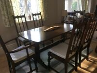 Ercol dining table and 6 chairs in lovely original condition and new cushion pads.