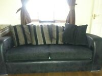Good quality black 2 piece sofa suite seats 7 people includes sofa bed