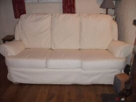 2 x 3-seater sofas and pouffe - cream coloured covers.