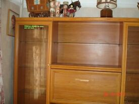 Large wood and glass display cabinet. Loads of storage. Excellent condition Comes apart for removeal