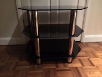 CHROME AND BLACK GLASS T.V UNIT IN EXCELLENT USED CONDITION FREE LOCAL DELIVERY 07486933766