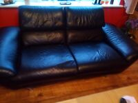 Black real leather 3 + 2 sofa seaters and large footstool