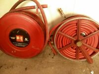 fire hoses on reels possible use for farm or building site