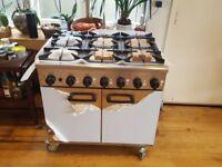 NEW! 6 Burner Oven Range Natural gas/ Stainless steel on castors