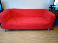 2x Red Ikea Klippan settees.