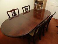 Reproduction mahogany extending dining table and four ribbonback chairs