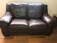 Brown leather two seater sofa, love seat