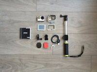 GoPro Silver Hero 4 - Lightly Used - Excellent Condition - Comes with Accessories